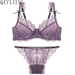 164817d4ca99a QIYIJING Newest Very Sexy Women Half Cup Lace Bra + Briefs Plus Size  Ultra-thin Sexy Plunge Bra Sets A B C D Cup Free Shipping