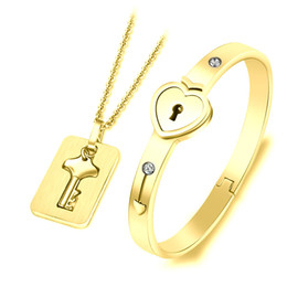 113db029d Gold Plated Heart Lock Love Jewelry Sets with Lock Key Pendant Necklace  Titanium Steel heart Lock Bracelet Key Necklace for Couples