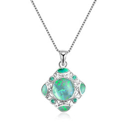 opal crystal necklace NZ - Classic Creative Design Hollow Flower Carving Blue Fire Opal Pendant Necklace Blue Crystal Zircon Inlaid Simple Fashion Women Wedding Party