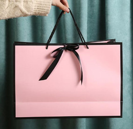 Wholesale customizable clothes resale online - Creative clothing store paper bag bow handbag pink gift bag customizable LOGO