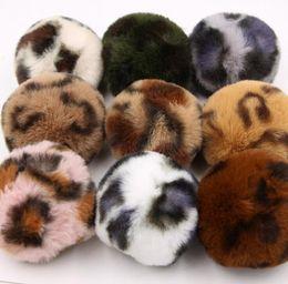 China 8CM 9 Colors Fluffy Rabbit Fur Ball Key Chain Sexy Leopard Print Pompom Artificial Rabbit Fur Keychain Women Car Bag Key Ring suppliers