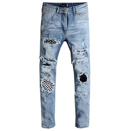Chinese  New beauty men's high street wind knee big hole knife cut needle stitching summer wash Slim feet jeans manufacturers