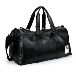 fb18f0666fca9 Top Qualität PU Leder Reisetasche Männer   Frauen Hand Gepäck Handtasche  Schwarz Reise Seesäcke Große Kapazität Duffle Totes wochenende tasche