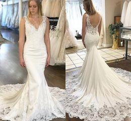 Hot Mermaid Pictures Australia - 2019 New Lace Mermaid Wedding Dresses Deep V-Neck Sweep Train Illusion Backless Country Castle Bridal Dresses Charming Hot Vestidoe De Noiva