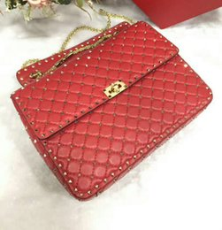 handbag rose lady NZ - 2019new genuine leather high fashion handbag diamond lattice metallic rose gold rivet full start travel women men big bag work gift OL 33cm