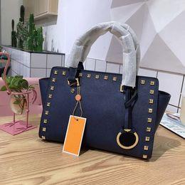 $enCountryForm.capitalKeyWord Australia - Fashion designer handbag brand women's shoulder bag brand design genuine leather rivet solid color bat bag 28*22CM designer shoulder bag