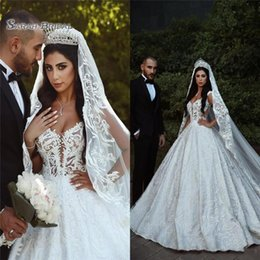 Wholesale 2020 Arabic A Line Wedding Dresses Sheer Straps Illusion Bodice Appliques Sexy Backless Bridal Dresses Cathedral Train