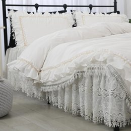 cotton baby bedding sets Canada - Free shipping princess ruffles white lace cutout embroidered luxury bedding set cotton ropa de cama bed skirt bedspreads YYX T200706