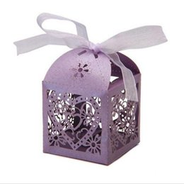 China Candy Boxes Love Heart Hollow Carriage Baby Shower Favors Box Gifts Party Favor Holders With Ribbon Wedding Party Supplies suppliers