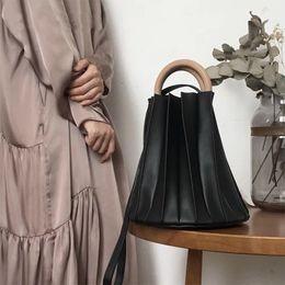 2575bb236e Vintage Three-dimensional Pleated Bucket Bag Wooden Ring Top Handle Women  Handbag Designer Crossbody Bags Evening Clutch Purse