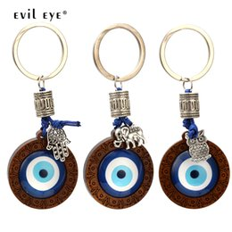 $enCountryForm.capitalKeyWord Australia - EVIL EYE Key Chain Wood Blue Turkish Eye Pendant Hamsa Hand Elephant Owl Charm Keychain Fashion Jewelry for Women Men EY6296