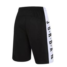 Vente en gros Shorts de basket-ball d'été hommes de remise en forme pantalons longueur de genou shorts d'exercice de football respirant à séchage rapide