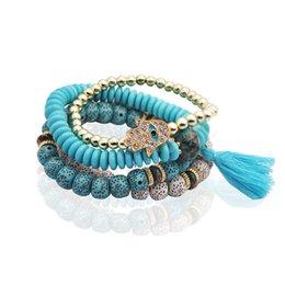 China harm Bracelets KMVEXO 4PCS Set Bohemian Turkish Palm Eyes Bracelets For Men Woman Fashion Wristband Resin Stone Tassel Bracelet Vintage J... supplier snake eye stone suppliers