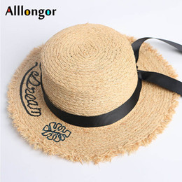 ce191c783ea61 Raffia Straw Hat Women 2019 Summer Sunhat Letter Print Black Ribbon Hat Bow  Temperament Flat Hats Beach Hat chapeau femme ete