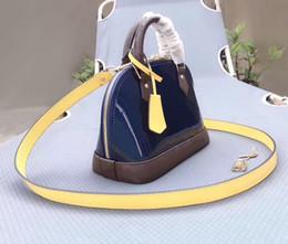 En gros de la mode classique sac fourre-tout en cuir verni de gelée d'épaule Messenger sac en relief zipper sac à main rétro sauvage