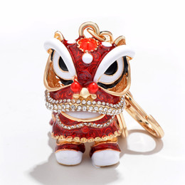 wholesale elephant holders 2019 - Chinese Festival Crystal Rotatable Lion Dance Men Car Keychain Lucky Elephant Key Chain Ring Women Bags Holder Charm che