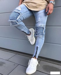 Venta al por mayor de Nuevos Mens Skinny jeans Casual Slim Biker Jeans Denim Agujero de la rodilla Hiphop Pantalones rasgados Lavado de alta calidad Envío gratis