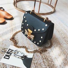 $enCountryForm.capitalKeyWord Australia - Factory wholesale women handbag sweet and lovely Pearl decorative chain bag foreign diamond fashion saddle bag personality bee lock shoulder