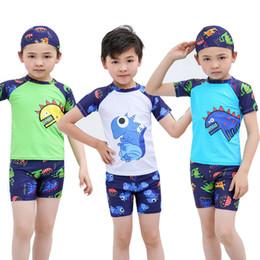 1bfb2b9209f32 New Boys Swimsuit Kids Baby Boys 3 Pieces Designer Swimsuit Short Sleeve  Rash Guard Cartoon dinosaur Shirt Shorts Swimming Cap Boys Swimwear