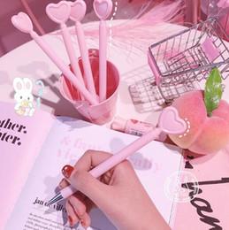 $enCountryForm.capitalKeyWord NZ - Creative heart-shaped pen girl pink love gel pen student office stationery black pen photo props cartoon
