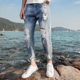 Man Fashion Jumpsuits Australia - KANYE Justin Bieber Men Jeans Ripped Jeans Fashion Designer Blue Rock Star Mens Jumpsuit Designer Denim Male Pants Leisure Trousers