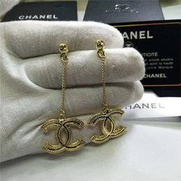 Venta al por mayor de Pendientes colgantes de diamantes de lujo de alta calidad de venta caliente con diamantes Pendientes de marca de metal de moda 20 aguja de plata de estilo