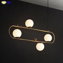 modern beds Canada - FUMAT White Glass Ball Dinning Bed Room Pendant Lamp Modern Home Decor Hanging Light Fixture Plating Gold Frame Postmodern