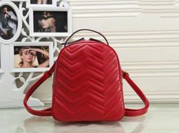 Venta al por mayor de Nueva cadena de mujeres de moda casual Mochila estilo bolso dama doble hombro bolso negro color rojo
