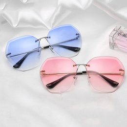 412f0c8a07 Hot-selling new large-frame lady s Sunglasses frameless trimmed ocean  lenses trend women s fashion metal sunglasses.