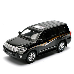 $enCountryForm.capitalKeyWord NZ - 1:32 Suv Land Cruiser Alloy Car Models 4 Open Door Pull Back Light Music Toyota Metal Vehicle Car Toys For Children Boy Collect J190525