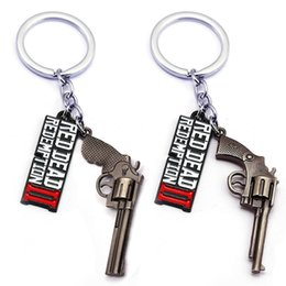 mexican toys NZ - 4 stlyes Game Red Dead Redemption 2 Keychain Keyrings Gun Toy Chaveiro Bag Jewelry Souvenir llaveros 0601897