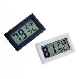 Venta al por mayor de 2017 nuevo negro / blanco FY-11 Mini Digital LCD Termómetro de ambiente Higrómetro Medidor de temperatura de humedad En la nevera de la habitación