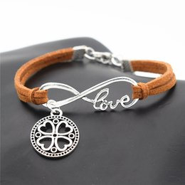 $enCountryForm.capitalKeyWord NZ - Boho Style Infinity Love Round Carved Four Leaf Clover Flowers Pendant Bracelets for Women Men Brown Leather Suede Jewelry Accessories Gifts