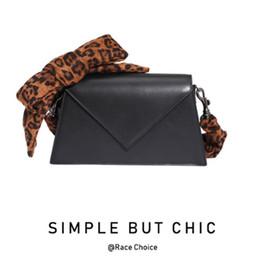 $enCountryForm.capitalKeyWord Australia - Elegant2019 Design Luxurious2019 Niche Chic Leopard Print Bow Hit Color Saddle Package Genuine Leather Single Shoulder Bag