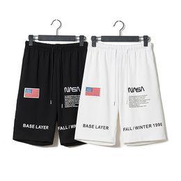 As novas roupas de verão são marcadas em conjunto com a bandeira americana e bordadas com um par de calças e shorts de astronautas. venda por atacado