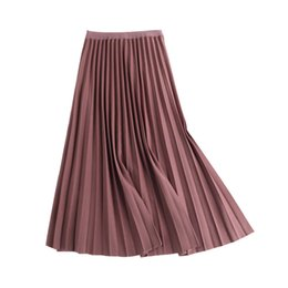 f04ba1b587b48e New Spring Autumn Solid Color Large Pendulum Long Pleated Korean A-line Elastic  Waist Tutu Skirt Women Maxi Skirts Q190508