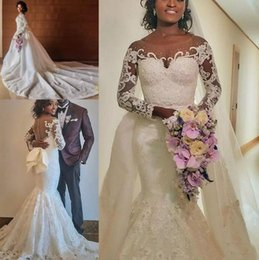 nude beaded lace mermaid wedding dress NZ - African Mermaid Wedding Dresses with Detachable Train 2020 Illusion Long Sleeve Lace Applique Beaded Garden Chapel Train Wedding Gown