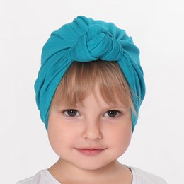 China New Baby girl's Knot turban hat Stretchy Cloche Cap Turban Bowknot Infant Cap Spring Autumn Kids Hats Beanie Accessories cheap cotton beanie infant suppliers