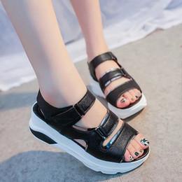 Chinese  Hot sandals female summer 2019 new flat bottom wild magic wand thick sponge cake women's shoes manufacturers