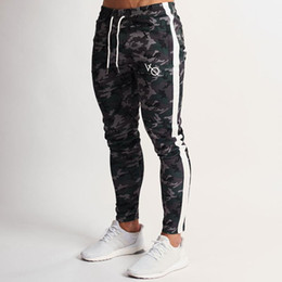 China 2019 Spring New Men Gyms Slim Joggers Gyms Woodland Camo Tricot Strike Tapered Sweatpants Casual Fashion Pant Long Pencil Pants cheap tapered pants suppliers