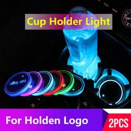 Light Logo embLem online shopping - 2PCS Led Car Cup Holder Coaster For Holden logo Light For colorado commodore ve badge astra emblem cruze captiva Accessories