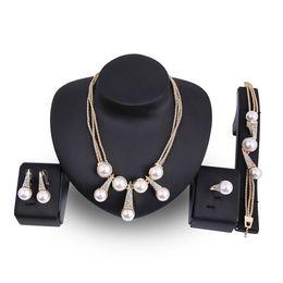 Imitation Pearl Jewelry Sets Australia - 18K Gold Plated 4-Piece Jewelry Set Luxury Elegant Rhinestone Imitation Pearls Necklace Earrings Bracelet Ring Bride Wedding Jewelry JS561