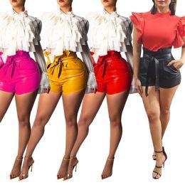 Plus La Taille Sexy PU Shorts En Cuir 2018 Femmes Ceintures Taille Haute  Bandage Moulante Shorts Automne Hiver Poches Club Party Bas 63769cc291c