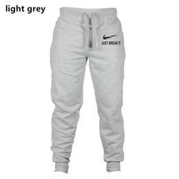 Discount wholesale pants for men - High Quality Jogger Pants Men Fitness Bodybuilding Gyms Pants For Runners Brand Clothing Autumn Sweat Trousers Britches