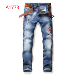 trends jeans UK - United States spring and autumn new trend men's mosaic smashed and worn to wash the cat to be slim Slim jeans