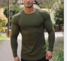 fitness clothing mens NZ - O-neck Longline Stylish Street Tops Long Sleeved Sports Bottoming Tees Male Clothing Mens Solid Color Fitness Tshirts