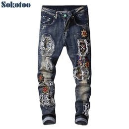 $enCountryForm.capitalKeyWord Australia - Sokotoo Men's fashion badge patches embroidery ripped jeans Holes patchwork blue stretch denim pants