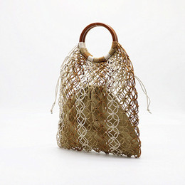 $enCountryForm.capitalKeyWord NZ - Hollow Out Paper Rope Wooden Handle Straw Bags for Women Large Capacity Beach Bags Handmade Rattan Bag Bohemian Knitting Tote