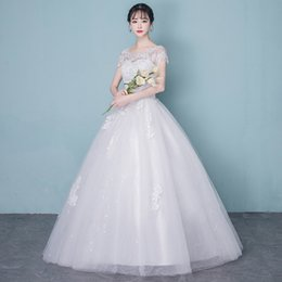 $enCountryForm.capitalKeyWord NZ - Sexy Jewel Illusion Beads Sequins Tiered dress floor length Sweep Train lace-up short sleeve bridal ball gown wedding dress custom made size