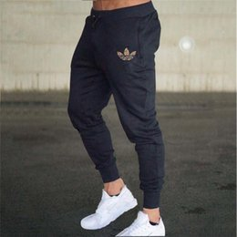 Mens lightweight casual trousers online shopping - 2019 Mens Joggers Casual Pants Fitness Male Sportswear Tracksuit Bottoms Skinny Sweatpants Trousers Gyms Joggers Track Pants